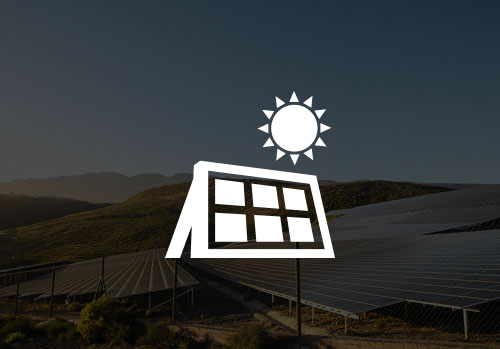 Solar panels with mountains in background