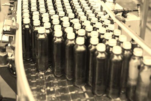 Bottles on machine in bottling plant